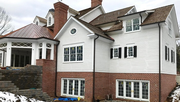 side of bryn mawr home with new wood windos