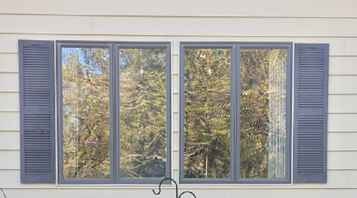 another before image of burlington home with new wood casement and double hung windows