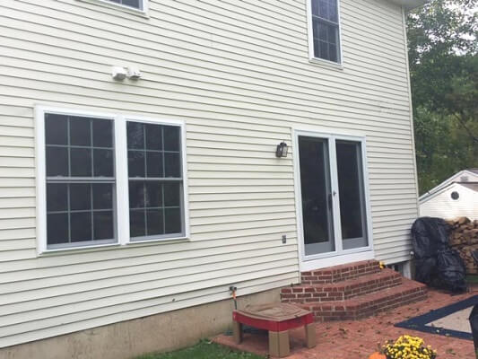 back after image of philadelphia home with new vinyl double hung windows and doors