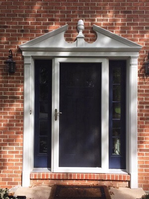 storm door image of philadelphia home with new vinyl double hung windows and doors