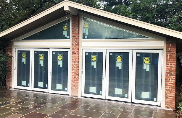 custom pool house in princeton gets new bifold patio doors