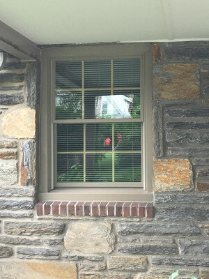 drafty window gets new life with double hung windows front of home