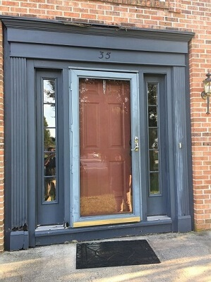 old wood entry door with storm door
