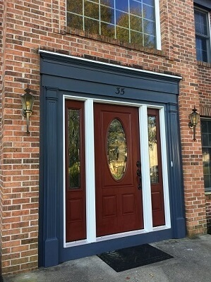 new fiberglass entry door with decorative side lights and trim