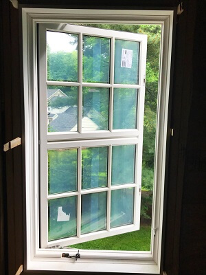 after image of gladwyne home with new wood custom casement window