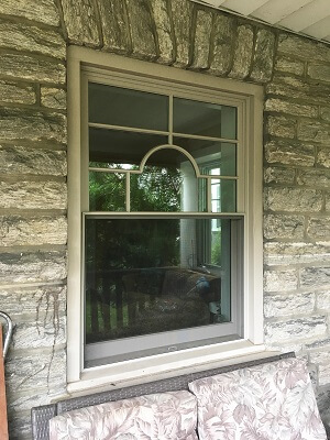 after image of philadelphia home with new wood double hung windows