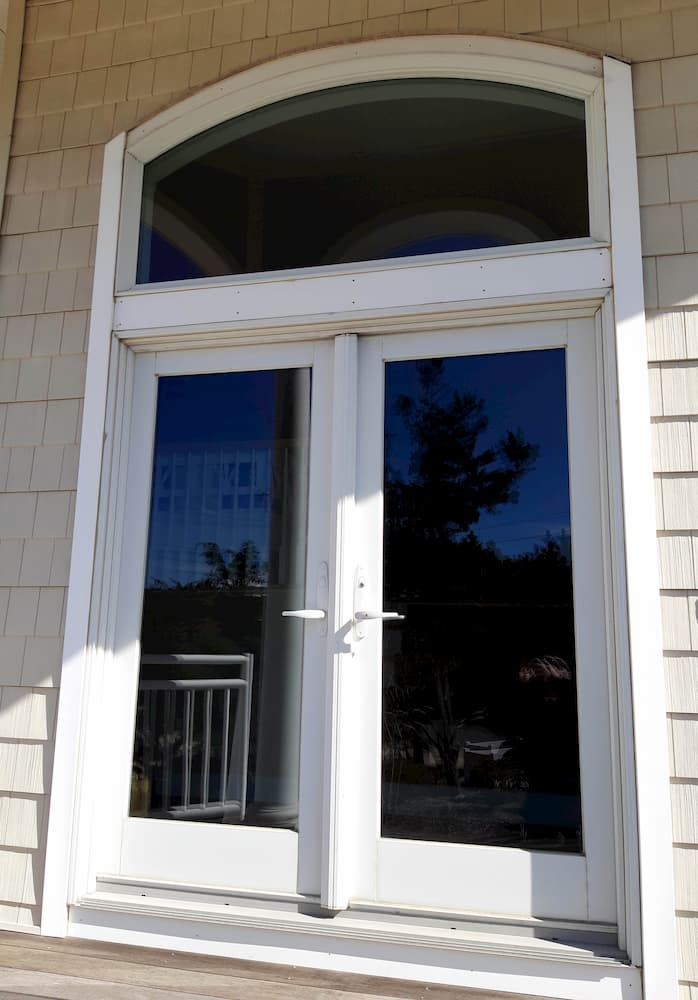 Old white double patio entry doors