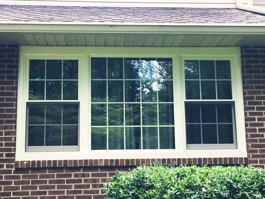 front of home in philadelphia gets new wood casement windows