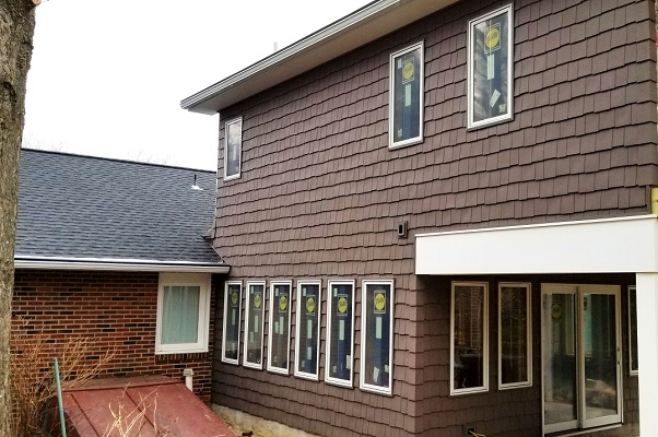 outside of newark home with new wood casement windows