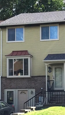 after image of philadelphia home with new vinyl sliding windows
