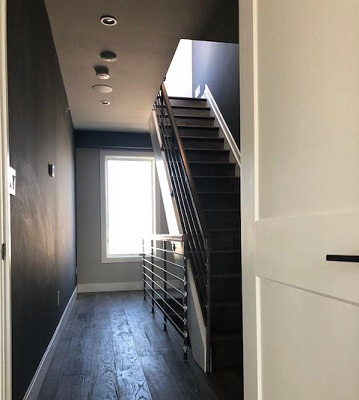 inside view of stairway in Queen Village home with new wood casement windows