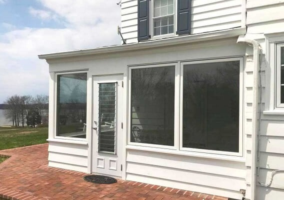 new large casement windows in sunroom replacement project