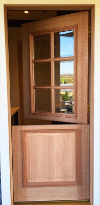 open door image of villanova home with new custom wood entry door