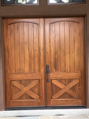 wood entry door on converted barn home
