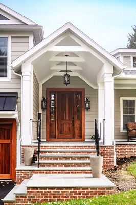 door image of wyomissing home with new wood double hung windows and wood entry door