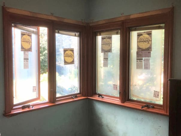 Interior view of four new wood casement windows in the corner of a room