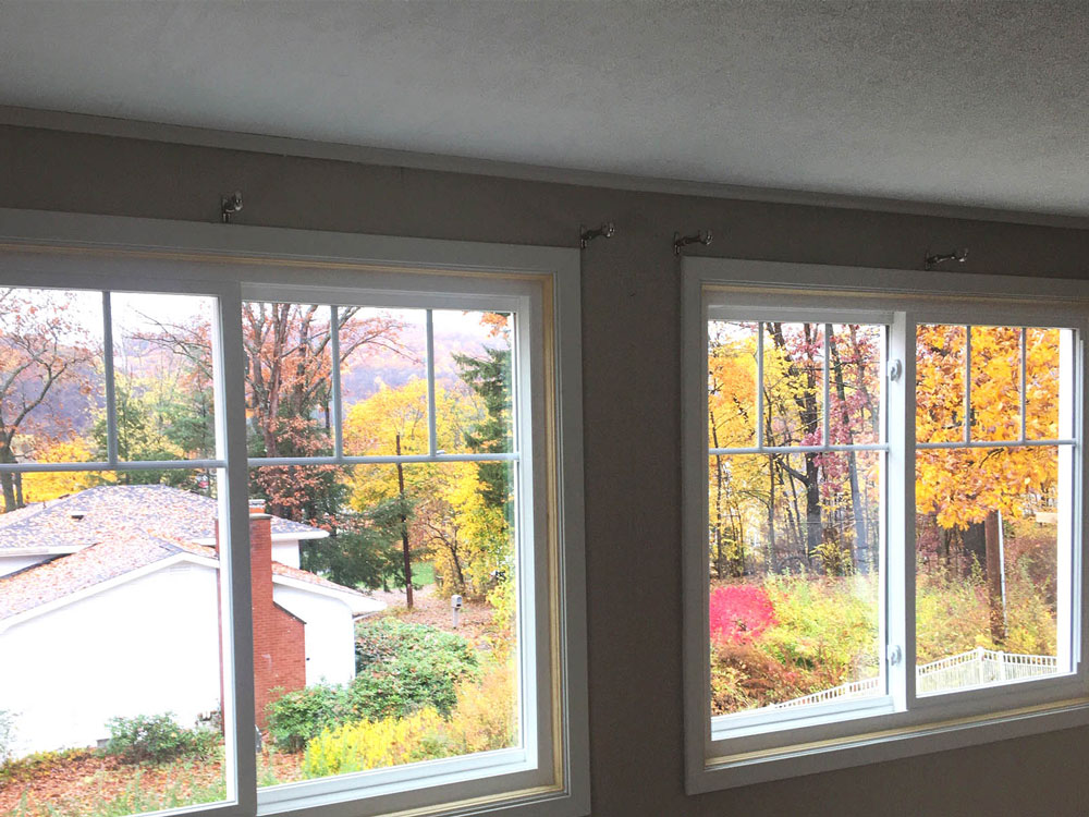 New side-by-side Pella 250 Series vinyl double-hung window on Conneaut Lake home