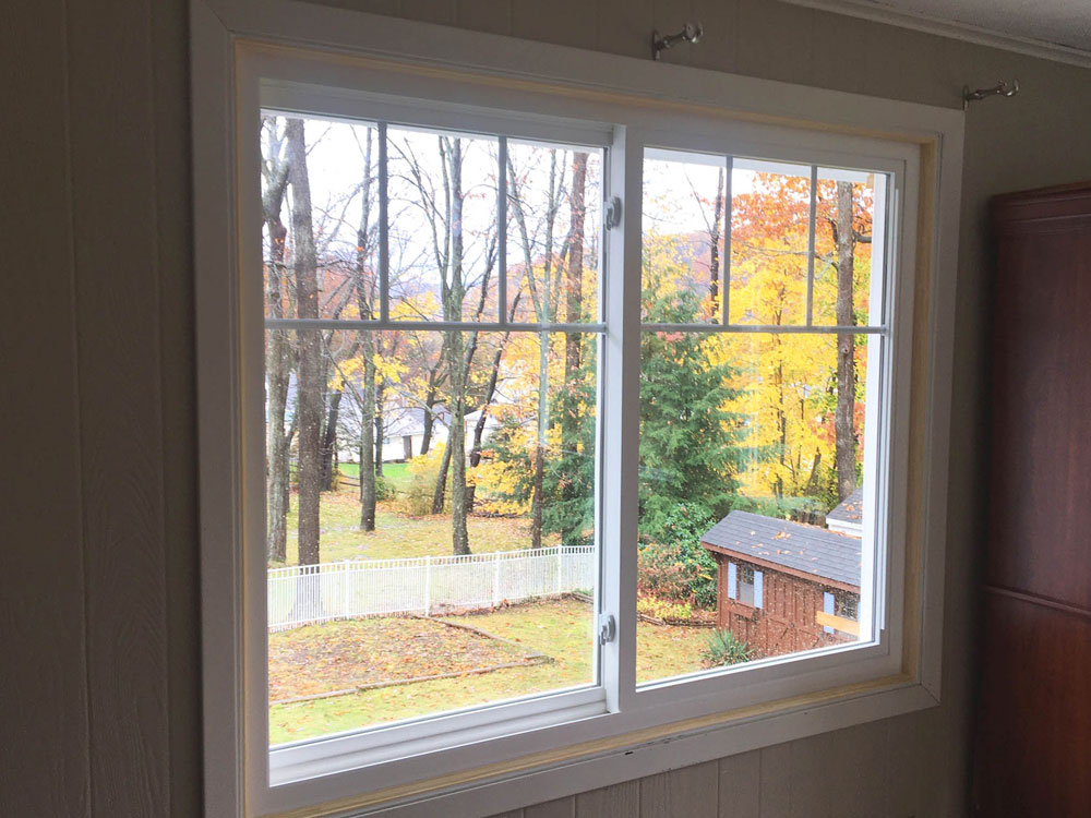Interior of new Pella 250 Series vinyl double-hung window on Conneaut Lake home