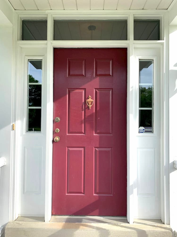Old wood entry door with sidelights and transom windows on Cranberry, Pennsylvania, home.