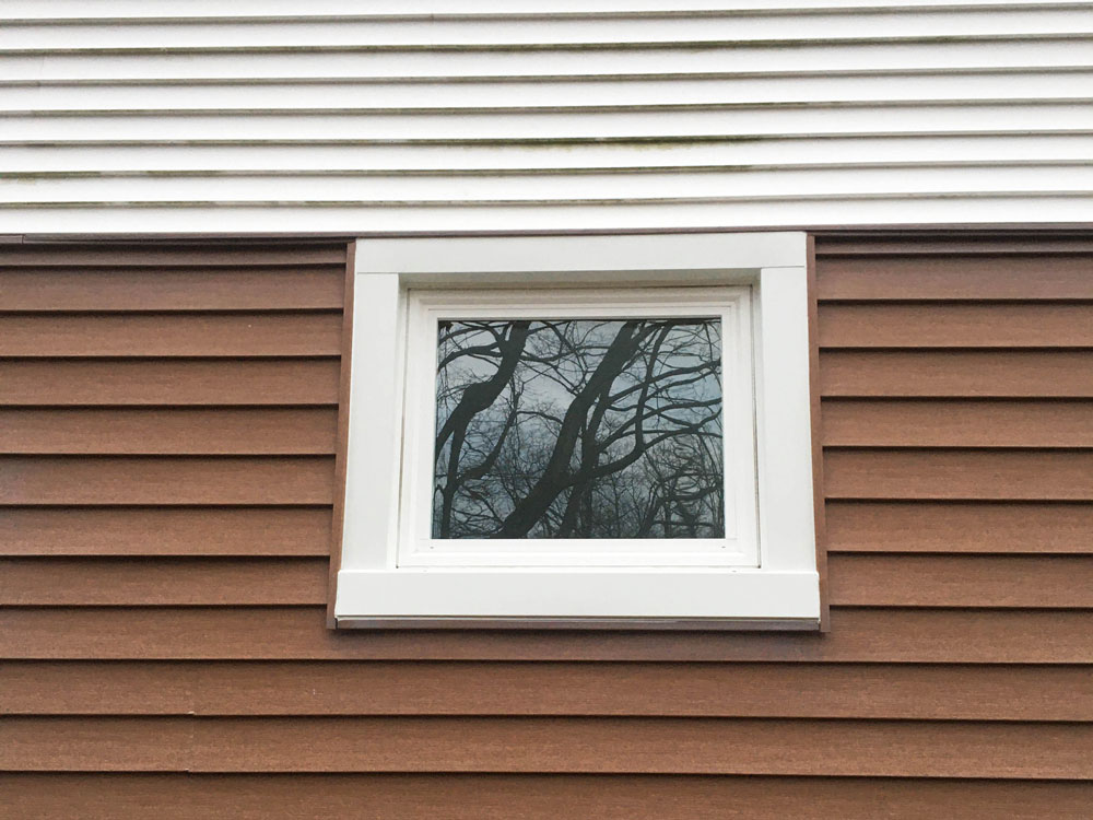 New Pella 250 Series vinyl awning window on Erie home