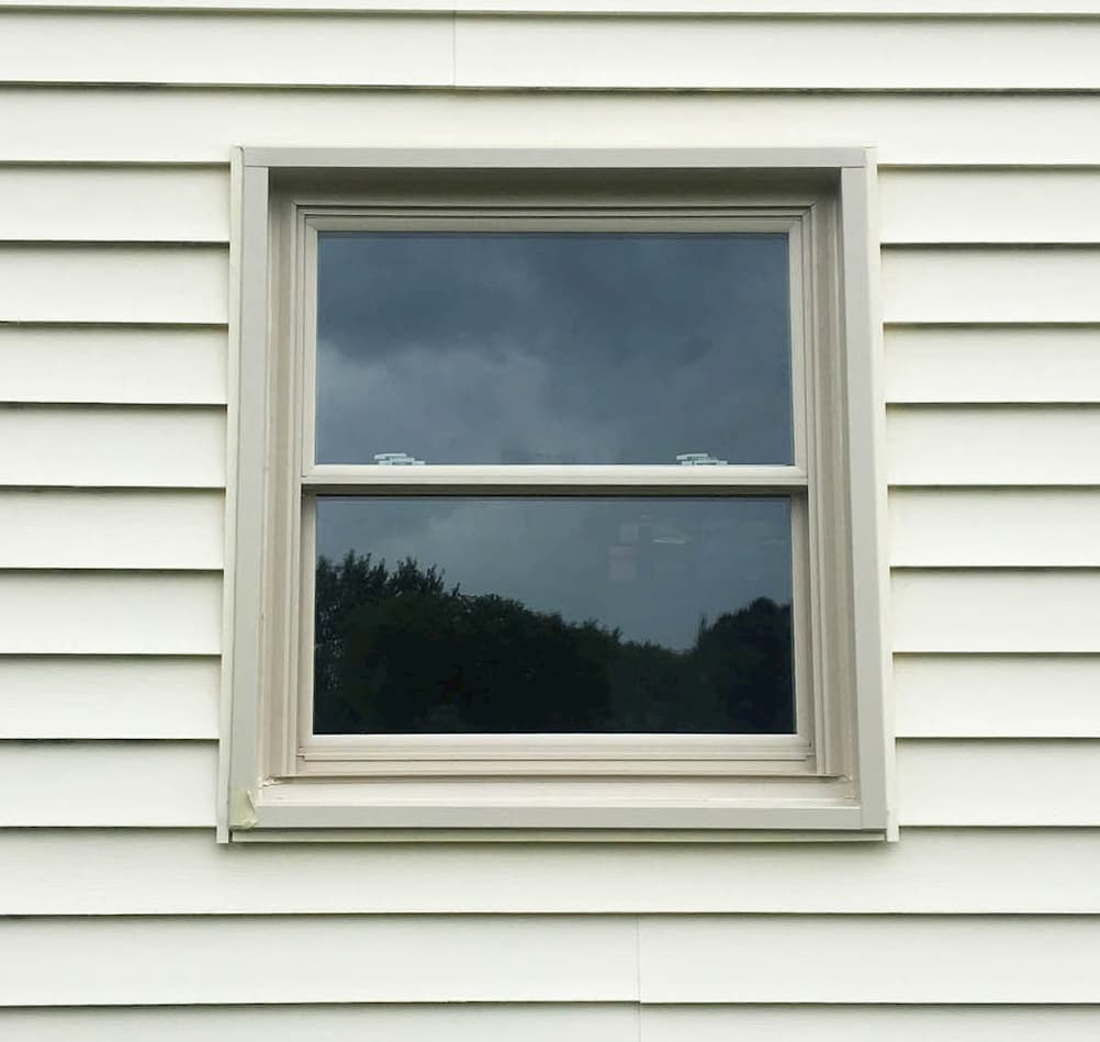 Exterior view of new vinyl double-hung window