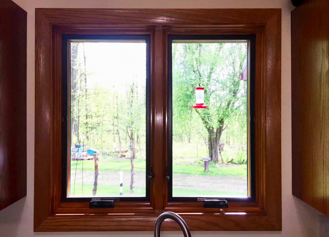 Interior view of new wood casement windows over kitchen sink.