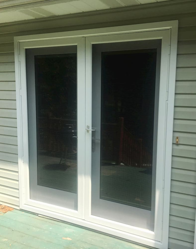 New wood hinged French patio doors