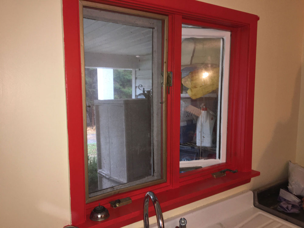 Red window in Erie, PA, home before whole-home window replacement
