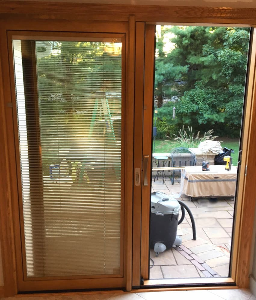 Interior view of new wood sliding patio door with between-the-glass blinds
