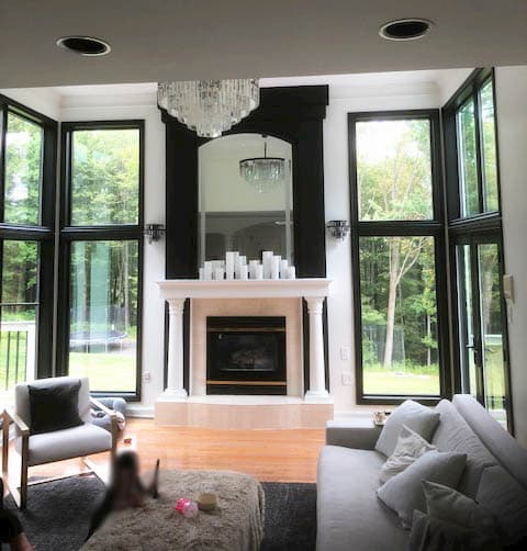 open living room with modern black windows