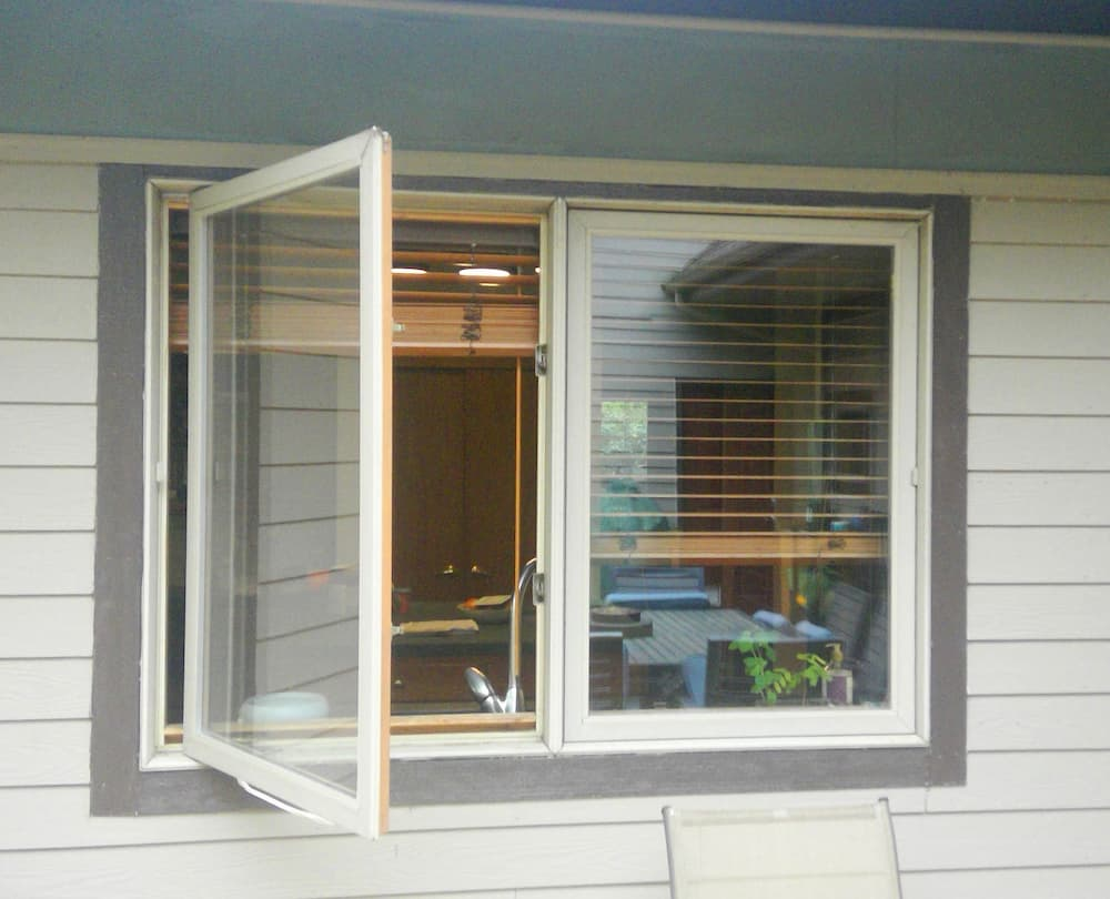 Exterior view of open casement window over kitchen sink