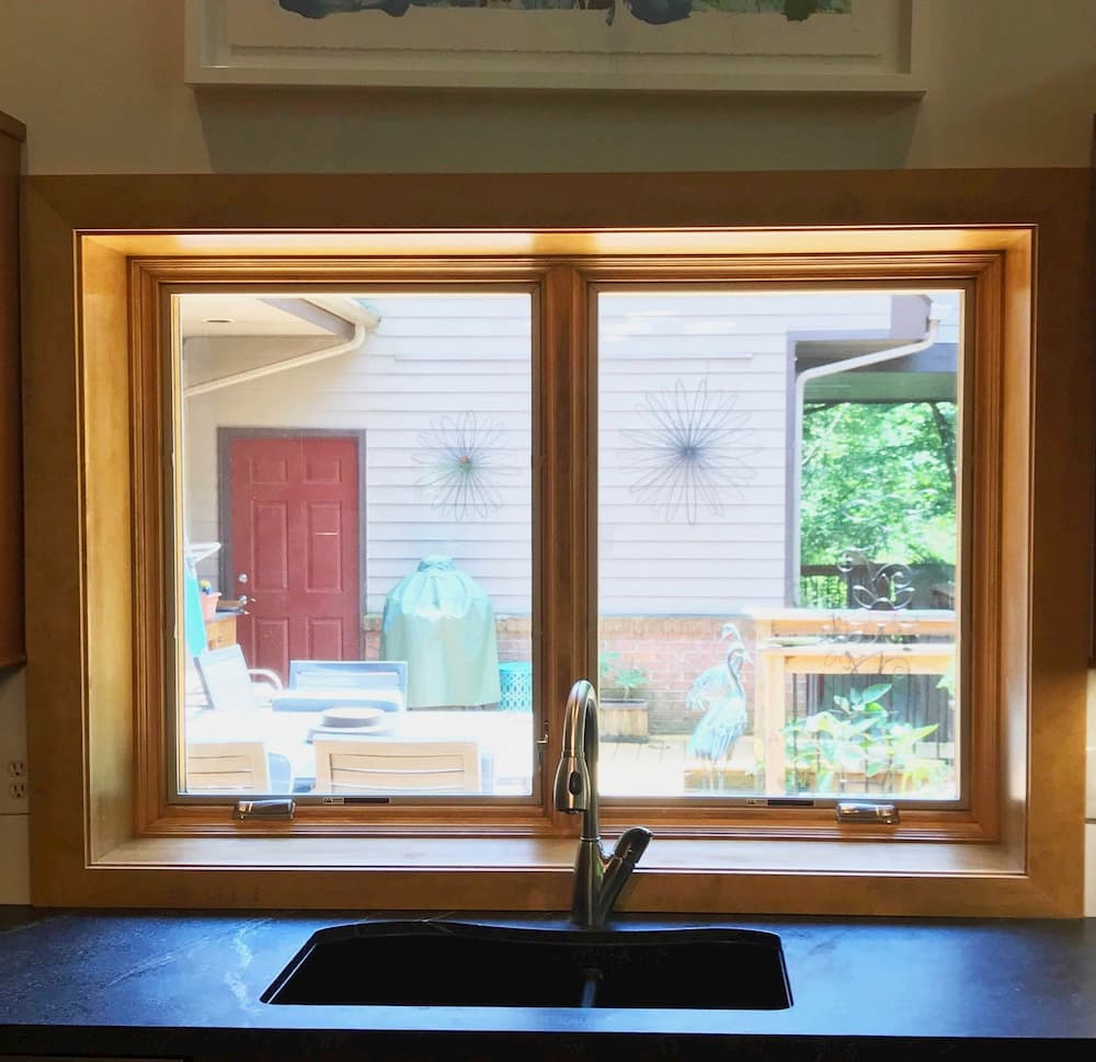 Interior view of new wood casement windows over kitchen sink