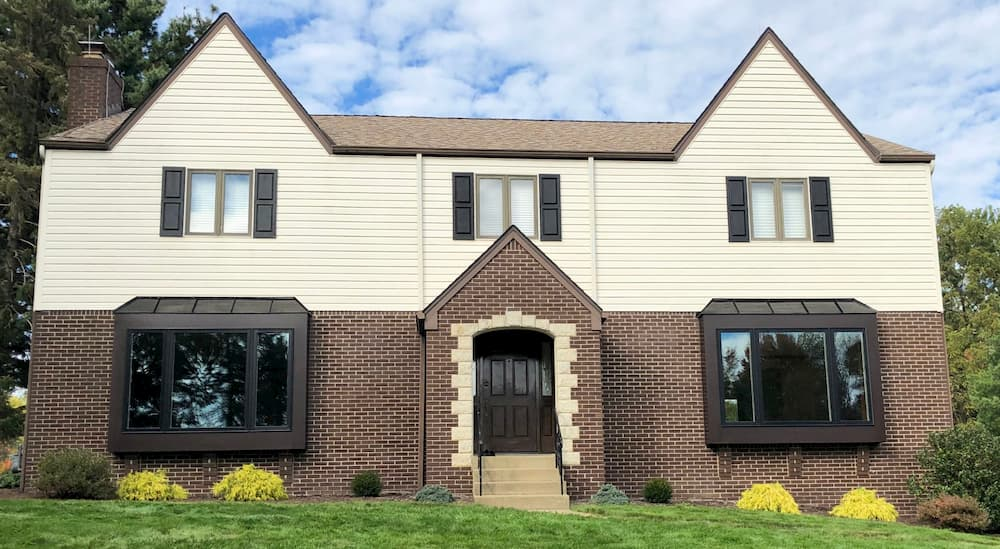 Front exterior view of home with new wood casement windows