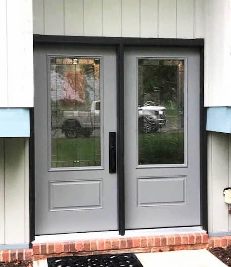 New gray fiberglass double entry doors with statement glass