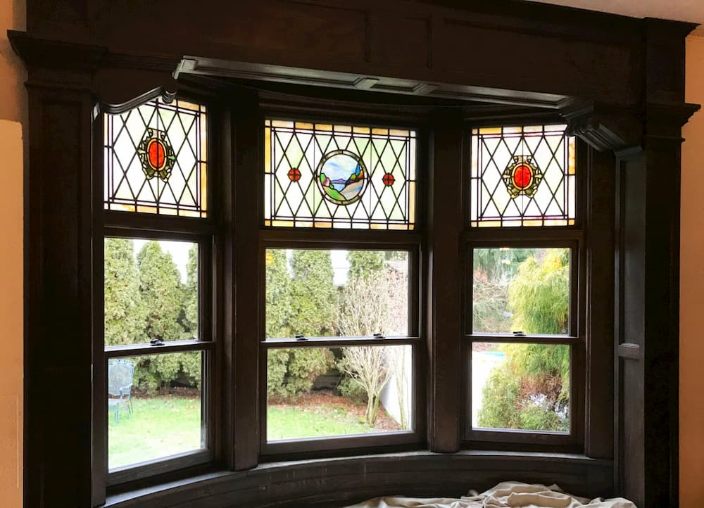 Interior view of new wood bay window with stained glass