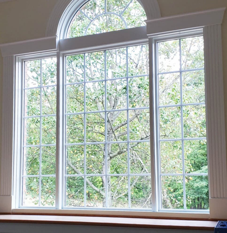 Wood picture windows with transom and traditional grille patterns