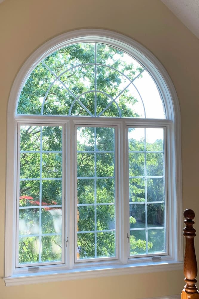 Interior view of wood casement windows with half-circle transom