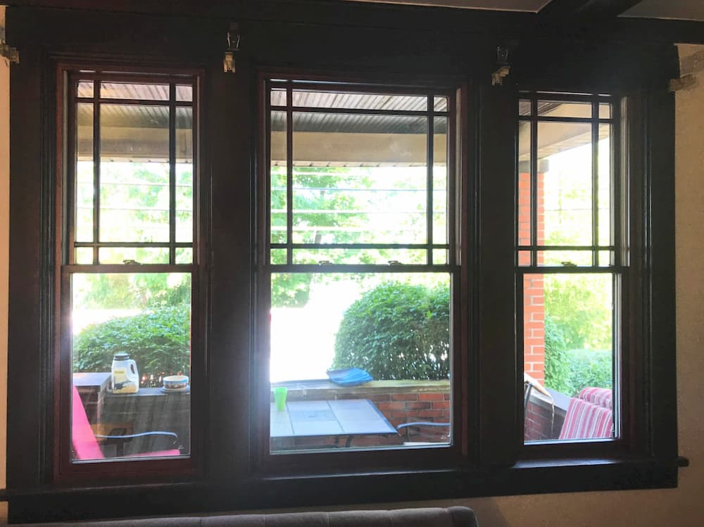 Interior view of black wood double-hung windows with top-sash prairie grille profiles