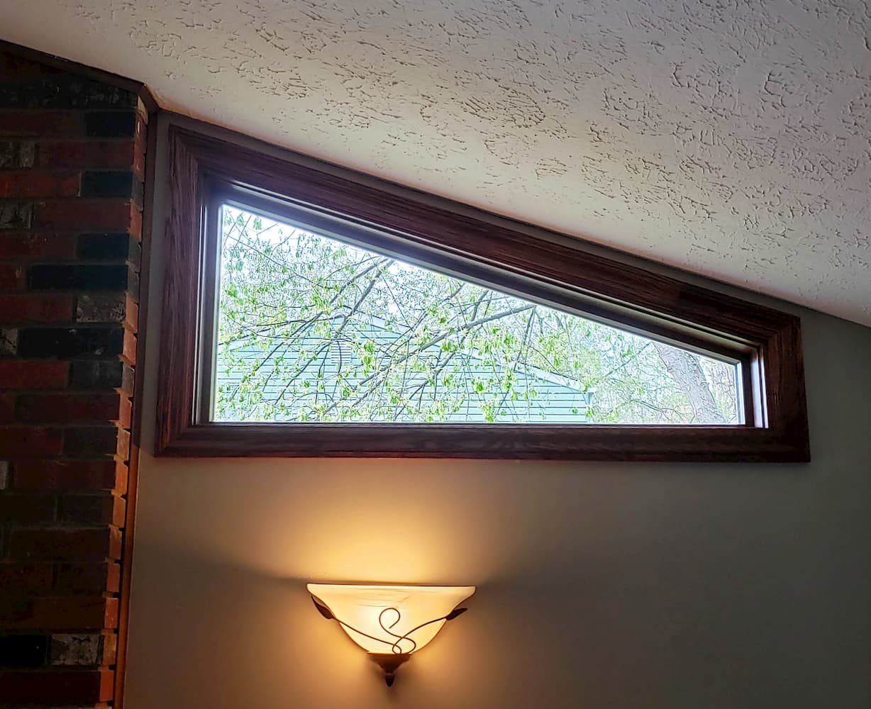 New special shape wood window lets light into room