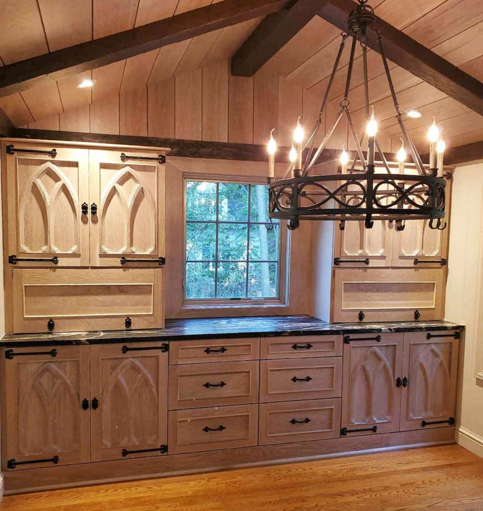 Wood kitchen with new wood casement window with traditional grille pattern