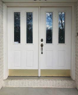 Old white double entry door