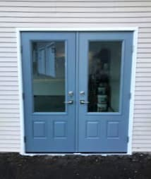 Exterior view of new blue fiberglass double entry doors