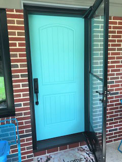 New turquoise fiberglass entry door with storm door