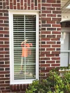 White vinyl double-hung window on red brick home