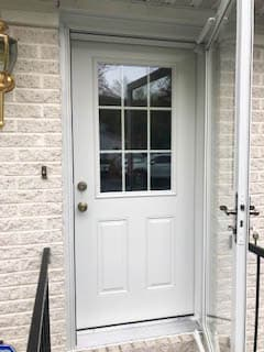 New white fiberglass entry door with traditional grille pattern