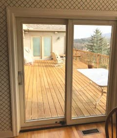 Interior view of new wood sliding patio door with a white finish