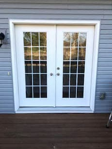 White French patio doors with traditional grille pattern