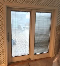 Interior view if old white sliding patio door