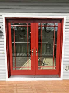Hinged French patio doors with a Prairie grille pattern and red finish