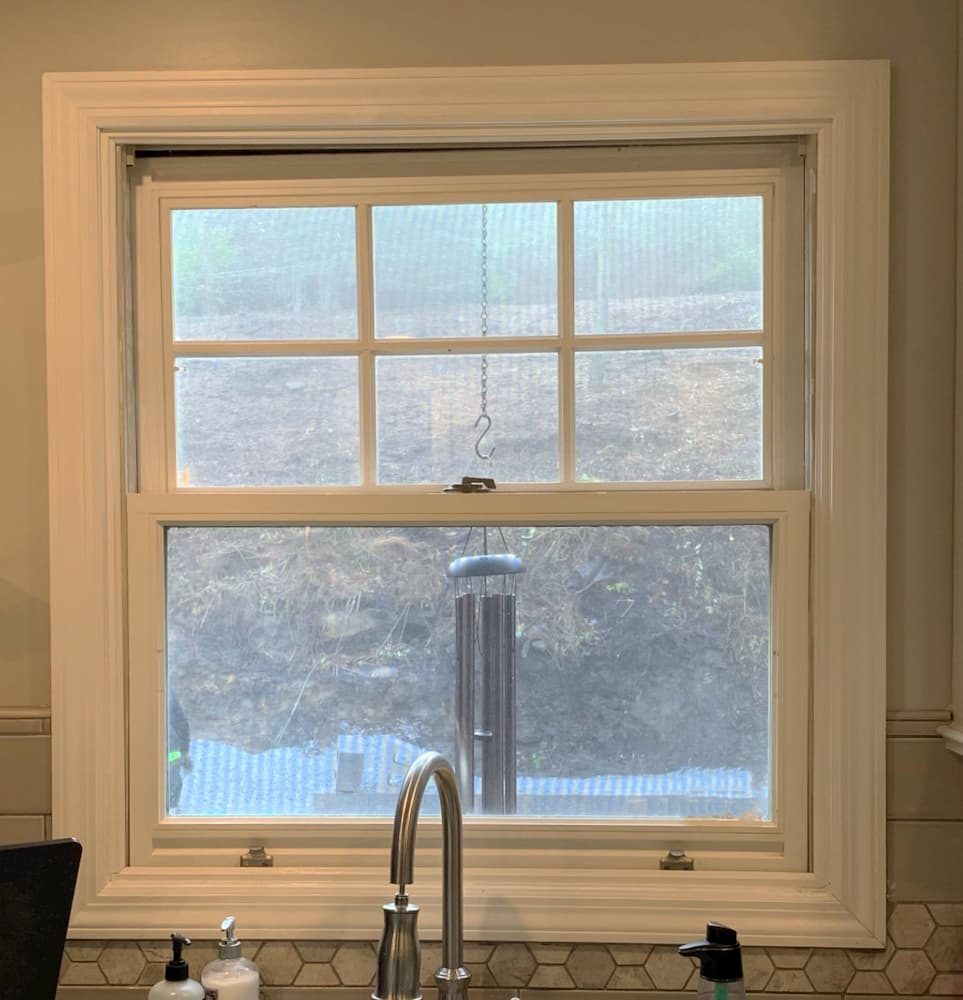 Interior view of old white double-hung kitchen window